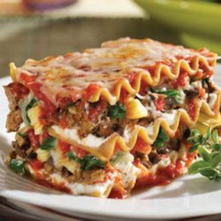 This Lasagna with Spinach is both filling and satisfying. Not only does it have sausage, ground beef and three types of cheese; it also has all those veggies stuffed in. With all of the other goodness, we are sure picky eaters won't mind.