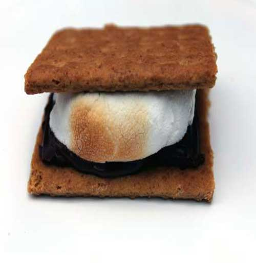 "The first record of s'mores was a recipe in a 1927 Girl Scouts publication. Yes, the name does seem to be derived from everyone wanting ""some more."" #dessert #smores #chocolate"
