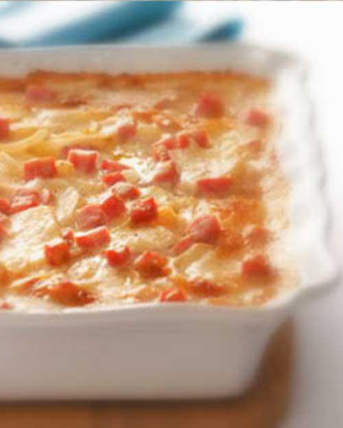 Recipe for Scalloped Potatoes with Ham and Cheese - Here is a good way to use up all of that leftover Easter ham that you know you will end up with.