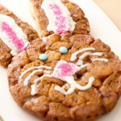 Recipe for Easter Bunny Monkey Bread - Easter bunny monkey bread is a festive way to present this breakfast favorite. Store bought cinnamon dough is rolled into balls and dipped into granulated sugar. This recipe quick, easy and oh so adorable.