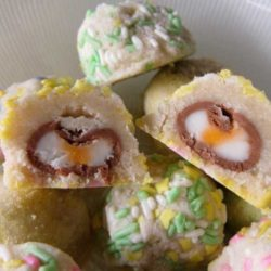 Cadbury Cream Egg Surprise Cookies Recipe - Here is a cookie that screams Easter. Pastel colored cookies, filled with Cadbury cream eggs! It's a treat inside of a treat.