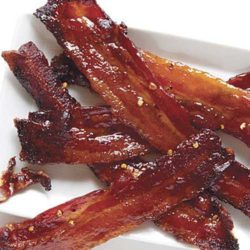 Recipe for Spicy Candied Bacon - What makes this the perfect Easter bacon? It's like spicy bacon candy. It's great on its own as an appetizer, chopped into a salad, or even on your Baked Beans!