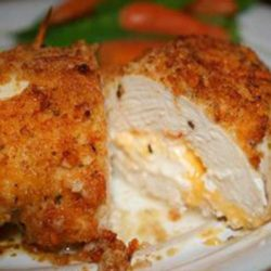 Not your everyday chicken dish! Stuffed with Cheddar and cream cheeses, then drenched with a garlic-lemon-butter sauce, your friends and family will be begging you to make this Garlic Lemon Double Stuffed Chicken recipe time and time again!