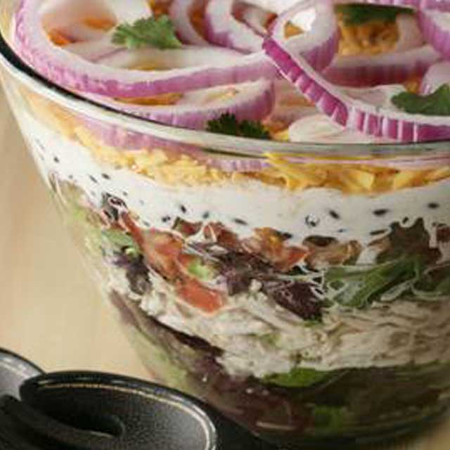 "Recipe for Layered Southwest Salad - Layer this salad in a beautiful clear glass bowl for the best ""wow"" factor. It looks great and tastes terrific. Just mix and match the flavors to match your family's taste."