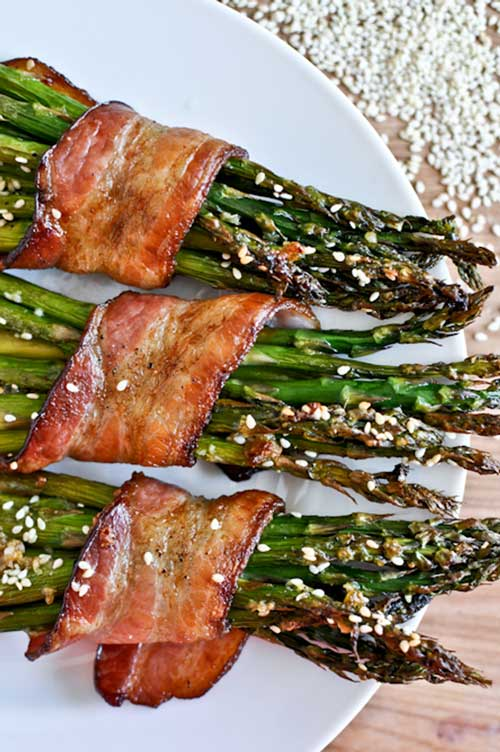 Recipe for Bacon Wrapped Caramelized Sesame Asparagus - I hate to say it, but these little green stems are growing on me.