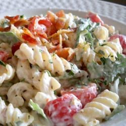 I humbly submit for your approval BLT Pasta Salad. It combines subtle herbs with peppery arugula and fresh tomatoes, all held together by a creamy base.