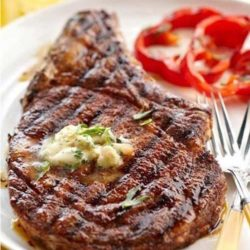Recipe for Cowboy Rib Eye Steak and Whiskey Butter - When it's nice outside, you can not go wrong with a perfectly grilled steak. And these rib eyes with whiskey butter are to die for. It's like meat heaven on a plate.
