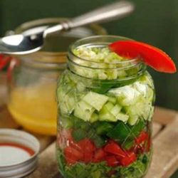 Recipe for Gazpacho Salad in a Jar - A crisp salad with the fresh flavors of chilled gazpacho is a perfect starter for any meal. For this version, the salad ingredients are layered in a jar and refrigerated. You can make one large jar of salad or prepare individual servings — perfect for outdoor dining.