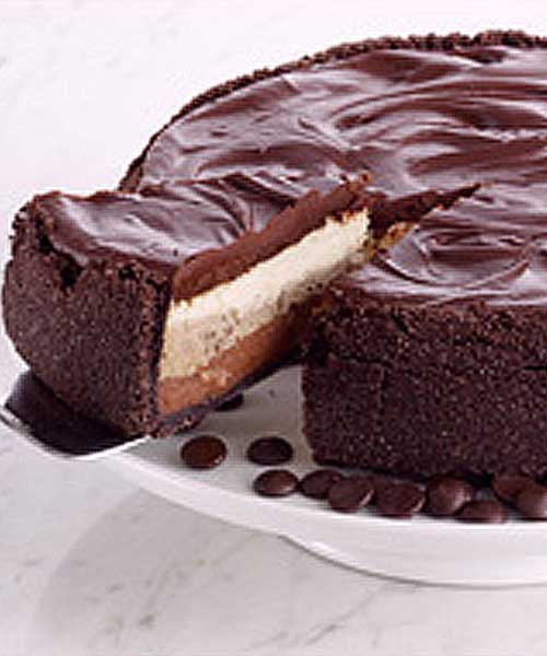 Recipe for Triple Layer GODIVA Dream Cheesecake - This is the perfect thing to bring when you're an invited guest -- easy to make and always a crowd pleaser!