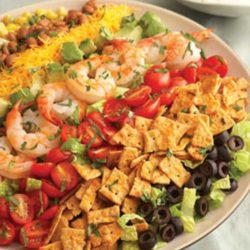 Colorful and flavorful ingredients like tomatoes, Cheddar cheese, avocado, corn and olives are easily arranged to make a salad that gets a delicious crunch from crumbled cheese crisps. It makes a beautiful presentation and is ready in just 30 minutes.
