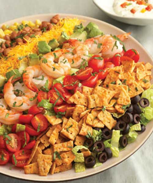 Colorful and flavorful ingredients are easily arranged to make this Rainbow Mexican Salad. It makes a beautiful presentation and is ready in just 30 minutes.