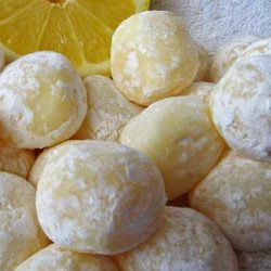Recipe for White Chocolate Lemon Truffles - The texture of these truffles are silky smooth. Hints of lemon ooze out of this velvety white chocolate. The best part is they are so easy to make.