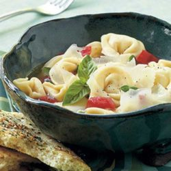 Recipe for Asiago Tortellini - When boiling water for the pasta, start with hot tap water and cover the pot with a lid. This is a surefire way to speed up your cook time. Serve this pasta dish with Black Pepper–Garlic Flatbread to soak up the basil-infused broth.