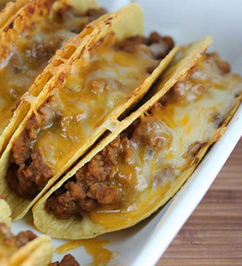 Recipe for Baked Tacos - I never thought about baking tacos in the oven before but it makes perfect sense. I really enjoyed how everything was warm and the cheese was melted.