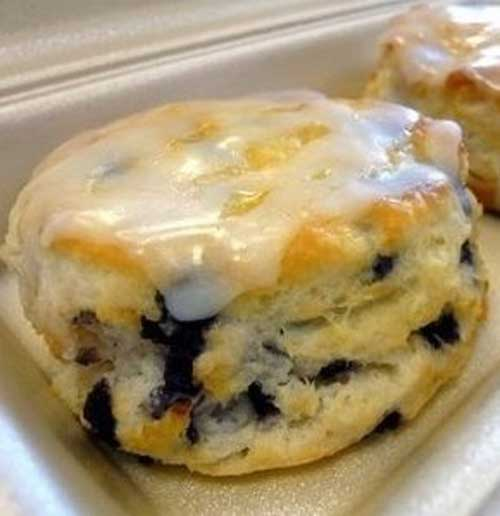 Does your breakfast usually consist of eggs and bacon or cold cereal and milk? Are you tired of eating the same ole food every single day? Why don't you try your hand at making these delicious Glazed Blueberry Biscuits?