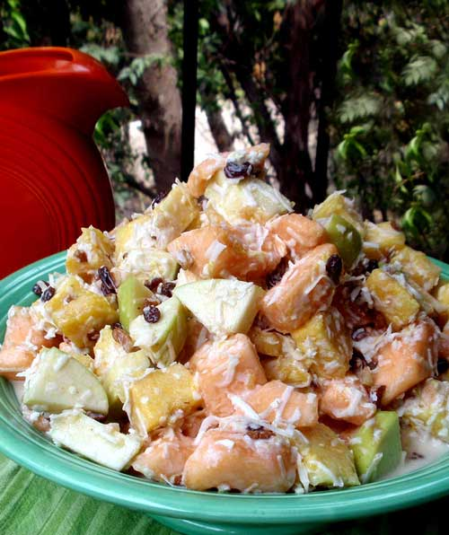 Recipe for Cantaloupe Fruit Salad - This is the ideal summer salad to accompany whatever you're grilling. It's healthful, cool and pretty. And don't think that added sugar will improve the taste. The natural sugars in the fruit combine perfectly with the tartness of the yogurt for a delicious, refreshing side dish.