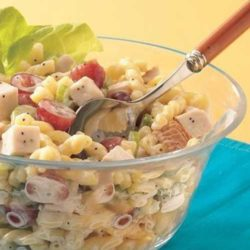 Recipe for Chicken Pasta Salad with Poppy Seed Dressing - Save time with deli chicken and prepared dressing to create this satisfying pasta salad.