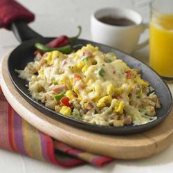 Recipe for Cheesy Cowboy Breakfast Skillet - Very good for breakfast or dinner, I'm sure they'll be lining up for seconds.