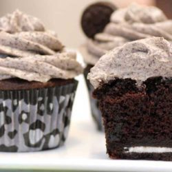 Recipe for Death By Oreo Cupcakes - You put a whole Oreo at the bottom of the cake. The cookie stays firm, which makes it a little interesting to eat against the soft cake, but it actually gave a really yummy crunch. Overall this is an amazing cake.
