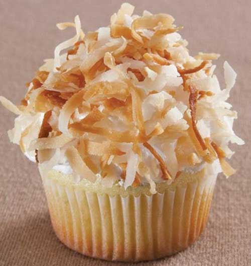 Recipe for Lime Cupcakes with Coconut Fluff Icing - The lime cupcakes are a delicious contrast between tart lime and mellow coconut icing.