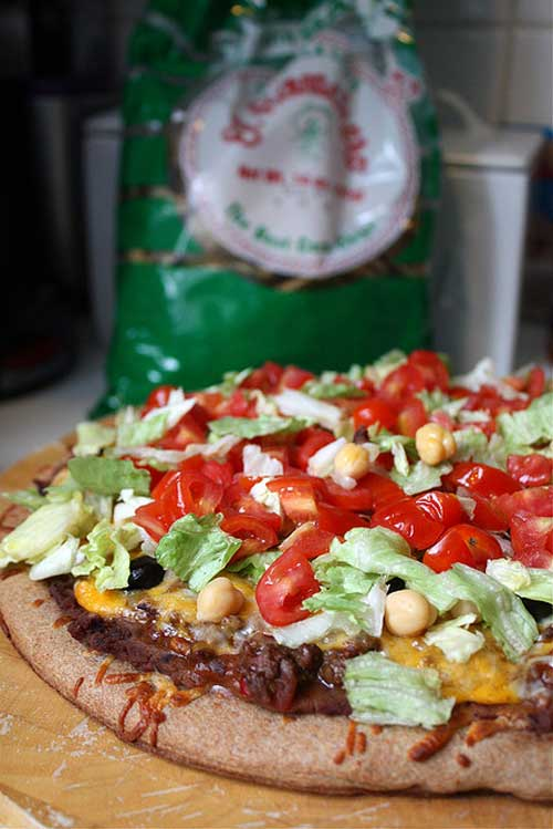 Recipe for Mexican Pizza - When I need a quick and easy dinner, I make these satisfying pizzas that capture the flavor of Mexico.