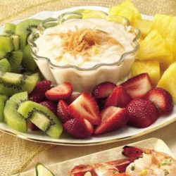 Recipe for Fruit with Pina Colada Dip - Take a trip to the islands with this fun fruit dessert, with kiwis and more dipped in a rum-and-coconut yogurt.
