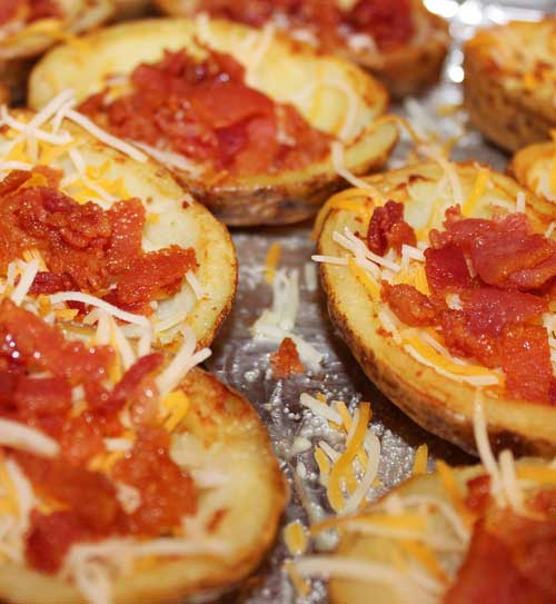 Recipe for Restaurant Style Potato Skins - Crispy bacon, ooey, gooey cheese and crispy yet soft potatoes combine to make the most awesome of appetizers!