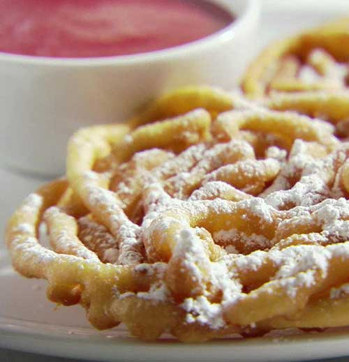Recipe for Funnel Cakes with Strawberry Sauce - These are so easy to make and everyone will love you for the nice surprise at your next get together or just a fun dessert to cheer up the kids!