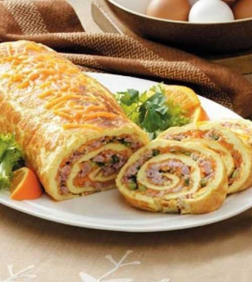 This brunch dish has wonderful ingredients and an impressive look all rolled into one! I love hosting brunch…and this special omelet roll is one of my very favorite items to prepare and share.