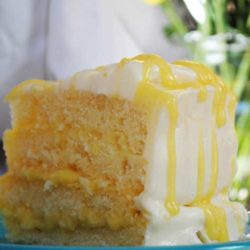 Recipe for Lemon Pucker Cake - Moist, buttery lemon cake filled with tangy lemon curd and encased in the perfect foil of sweetness, a decadent white chocolate buttercream.