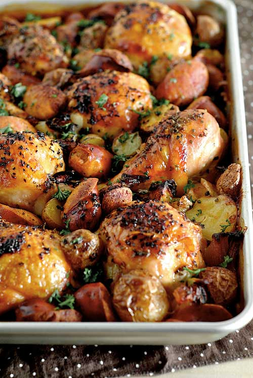 This Spanish Chicken with Chorizo and Potatoes really just involves throwing everything into the tray, no marinade, no cutting of various vegetables and no washing of a sink full of dishes!