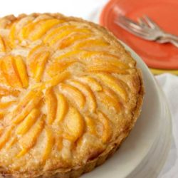 Recipe for Dulce de Leche Peach Tart - Fresh peaches and caramel are a natural fit, and this crisp summer tart shows off both flavors. The peaches caramelize in the oven, and their juices soak the filling with caramel peachiness. Good stuff.