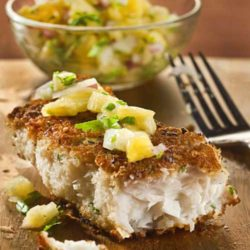 "Recipe for Macadamia Coconut Crusted Fish - ""Crispy-crunchy gets our vote every time,"" wrote JeanMarie Brownson in her column Dinner at Home. Her memorable pan-fried fish dish won our vote, and stomachs, handily."