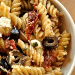 Recipe for Mediterranean Pasta Salad - This colorful pasta salad recipe comes together in minutes and is sure to steal the show at any picnic or dinner table.