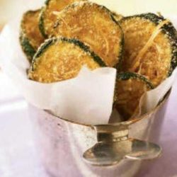 Breaded, oven-fried zucchini chips taste like they're fried, yet they are baked and amazingly crispy. These chips make a healthy substitute for French fries or potato chips.
