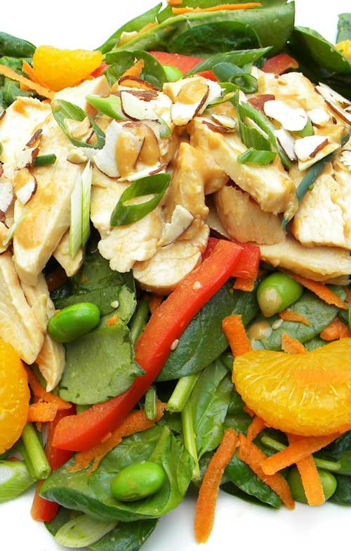 Recipe for Asian Chicken and Spinach Salad - Loaded with fresh, vibrant veggies, tender poached chicken and a flavorful dressing, this salad makes for a satisfying meal.