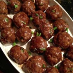 Recipe for Asian Style Meatballs - These tasty meatballs have a great punch of Asian flavors. Set a plate out of these easy-to-make meatballs and they'll disappear before you know it!
