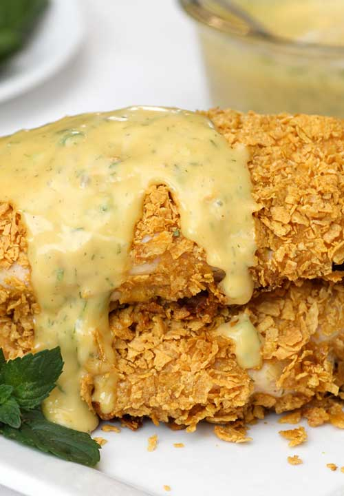 This Crusted Honey Mustard Chicken is a total comfort food with the crunchy breading and delicious sauce, and a good alternative to just plain baked chicken.