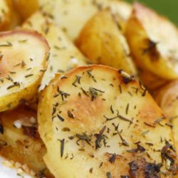 Recipe for Garlic and Oregano Roasted Potatoes - Roasted to perfection with lemon, oregano and garlic. These potatoes are sure to have your family asking for seconds.