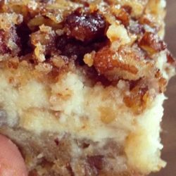 "You can't go wrong with a layer of shortbread, a layer of cheesecake and a layer of pecan pie in every bite! My daughter calls these Pecan Cheesecake Squares, ""squares of heaven."" I think after you try them, you'll see why!"