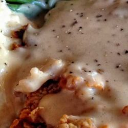 Recipe for Chicken Fried Steak - These crispy steaks smothered in gravy will earn raves when you serve them for dinner. You may almost feel guilty when you see how easy it is to make.