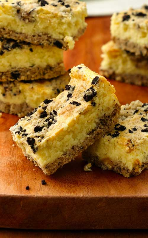 Recipe for Cookies and Creme Cheesecake Bars - Wanting a quick and easy dessert, that they will all love? Then give this extra-easy 3-step cheesecake recipe a try!
