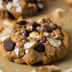 Recipe for Toasted Coconut Chocolate Chip Cookies - Turn a traditional chocolate chip cookie into something amazing by adding in toasted coconut. Trust me you'll need a full glass of milk to wash down this crispy and chewy treat.