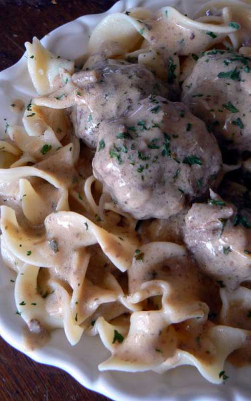 Recipe for Swedish Meatballs on Noodles - Nothing beats homemade meatballs smothered in a creamy gravy sauce, and they taste much better than the IKEA version!