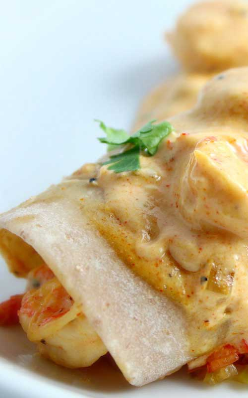 Recipe for Creamy Cajun Shrimp Enchiladas - This creamy shrimp sauce is also delicious served over pasta or steamed rice. As with many spice-based recipes, the flavors deepen the longer they have time to blend with the other ingredients.