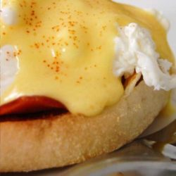 Recipe for Eggs Benedict - Hot buttered English muffins, Canadian-style bacon, and poached eggs are topped with a heavenly drizzle of hollandaise sauce. Breakfast does not get any better!