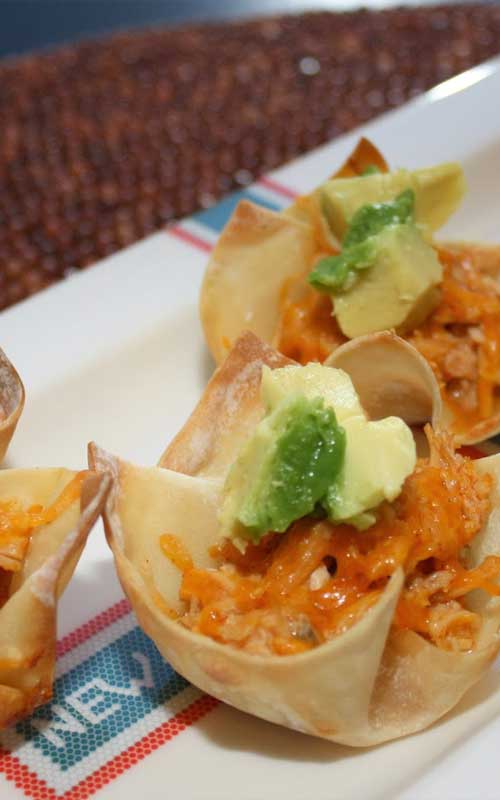 Recipe for Chicken Enchilada Cups - These individual chicken enchilada cups will absolutely thrill your family. Everything you love about chicken enchiladas, piled into a few bites!