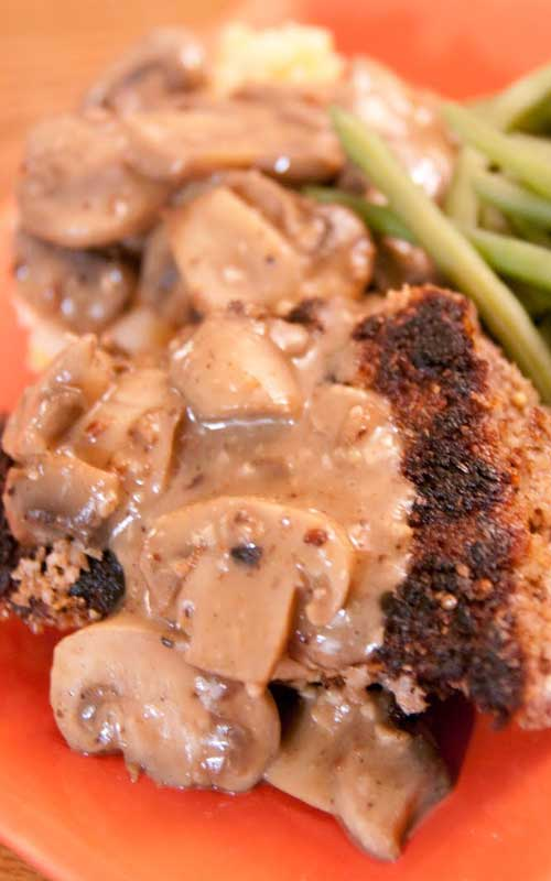 Recipe for Country Fried Steak with Mushroom Gravy - London Broil, pounded and breaded in a flavorful whole grain breading and cooked to a medium-rare. It was delicious, but the mushroom gravy was the best part!