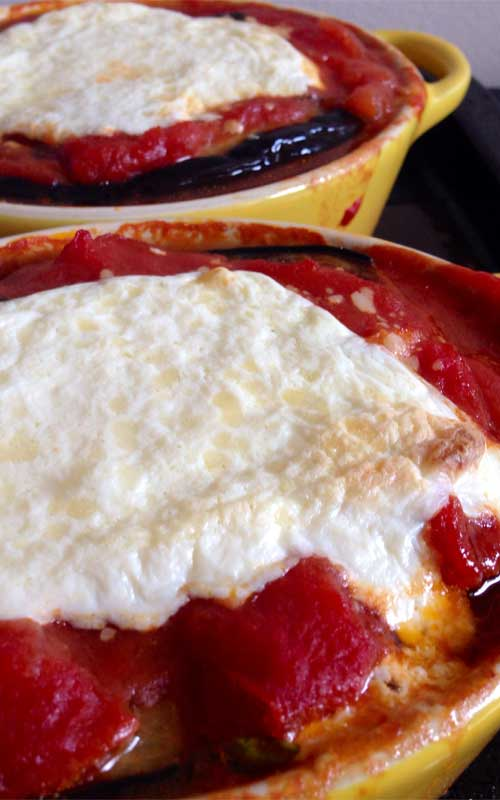 Recipe for Melanzane alla Parmigiana - Eggplant Parmesan - This is a healthier version of the traditional Italian-American juggernaut; it omits breading and frying the eggplant, and instead calls for roasting the eggplant until golden brown.