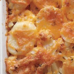 Recipe for Potato, Cauliflower, and Cheddar Bake - Adding cauliflower to a potato bake may seem crazy, but it adds great texture. A cheesy topping is a nice change of pace from the usual creamy casserole too.